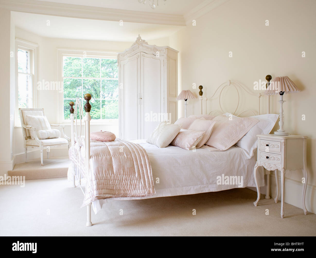 Cream Colored Bunk Beds Pale Pink Silk Quilt And White Bedlinen On White Wrought