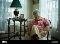 Old man sleeping in living room chair Stock Photo, Royalty ...