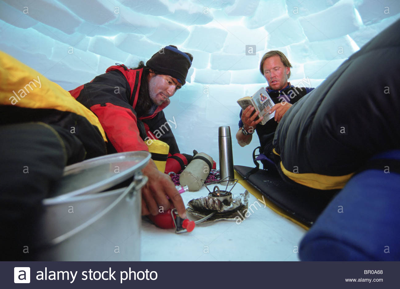 Denali Camp Stove Two Mountaineers In An Igloo Light Up A Camp Stove Stock Photo