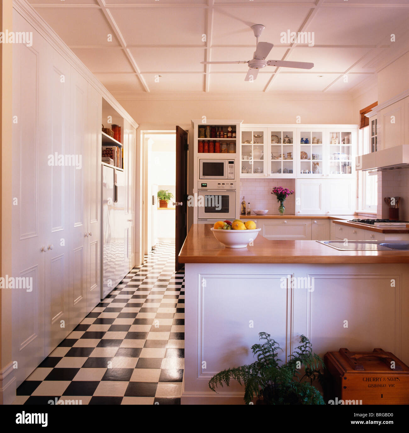 stock photo blackwhite checkerboard vinyl flooring in large modern white kitchen kitchen flooring vinyl Black white checkerboard vinyl flooring in large modern white kitchen with wooden worktops on fitted units