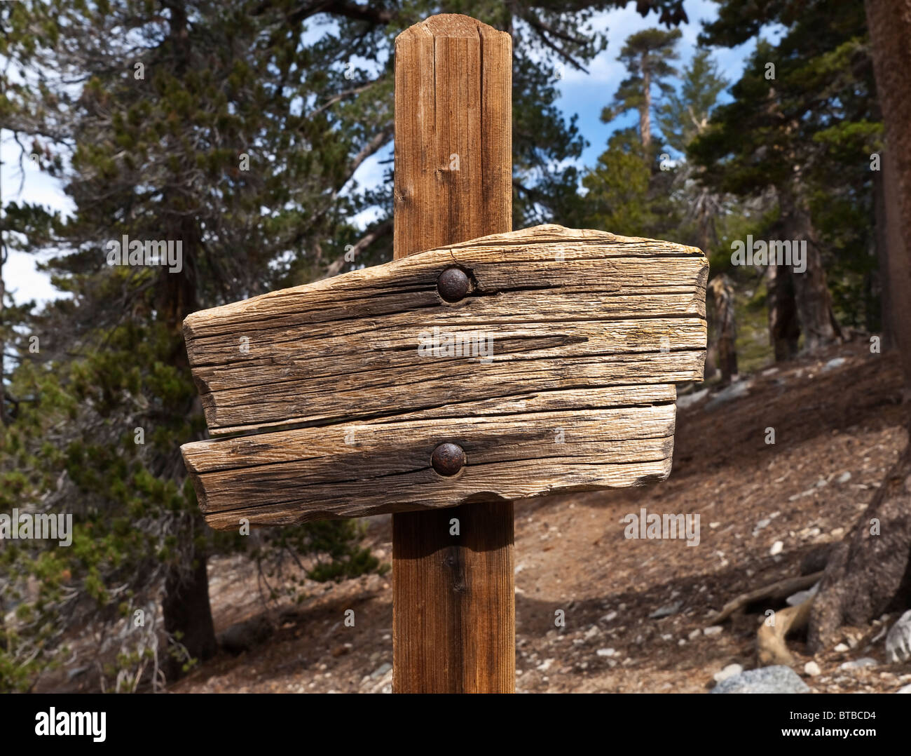 Rustic Blank Wooden Sign On A Hiking Trail High In The Mountains Stock Photo Alamy