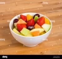 Food, Fruit, Salad, White bowl of fresh fruit salad on a ...