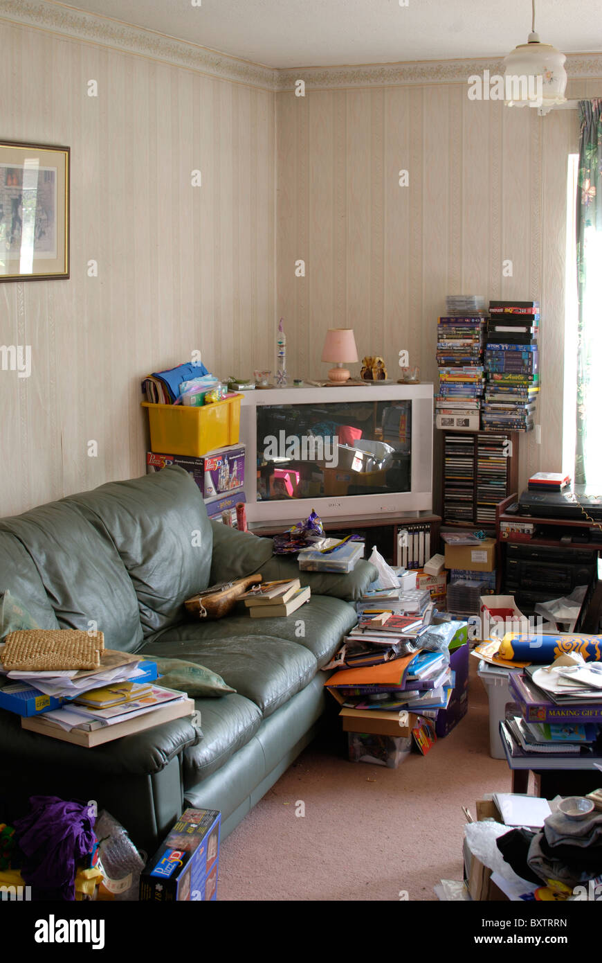 Images Stock Rubbish Very Messy And Untidy Cluttered Lounge Room With Books