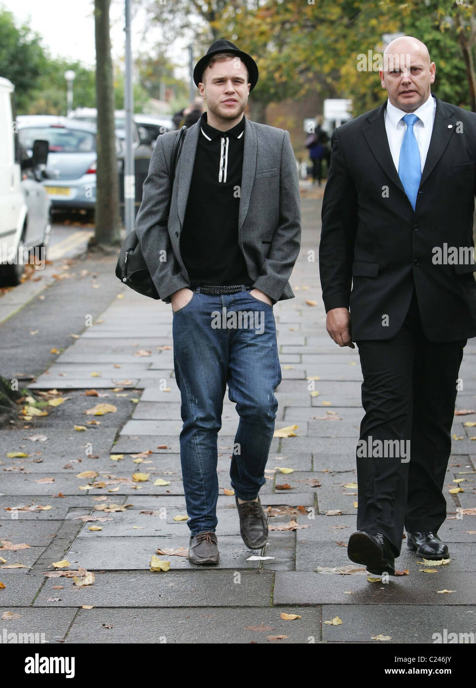 Stock photo x factor finalist olly murs steps out of the house to go for lunch accompanied by a security guard london england 03 11 09
