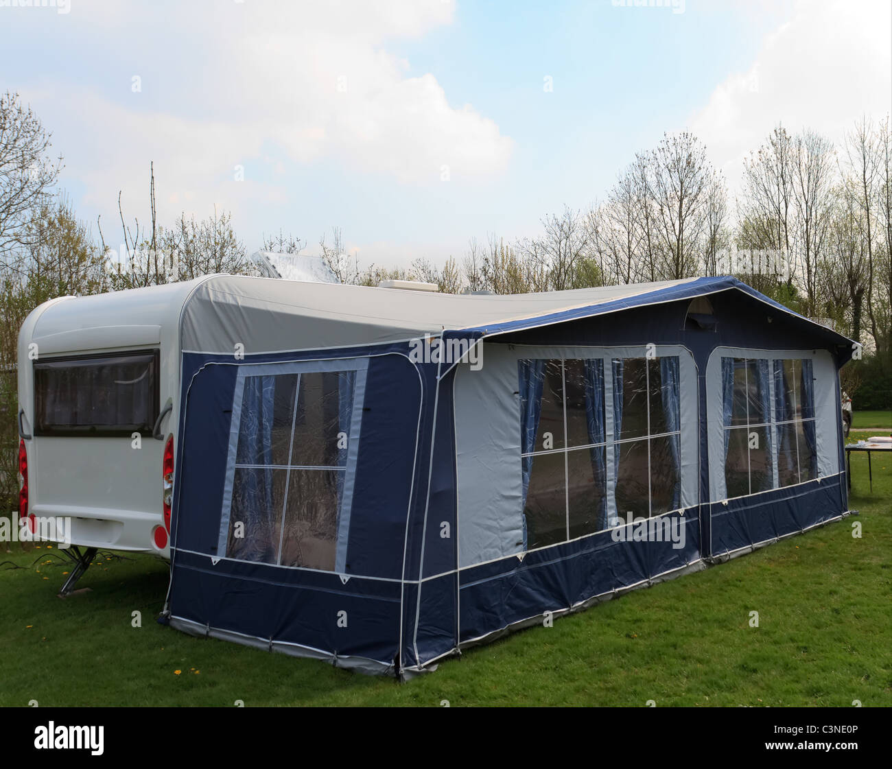 Trailer Curtains Long Trailer Caravan With Awning Tent With Blue Curtains Stock
