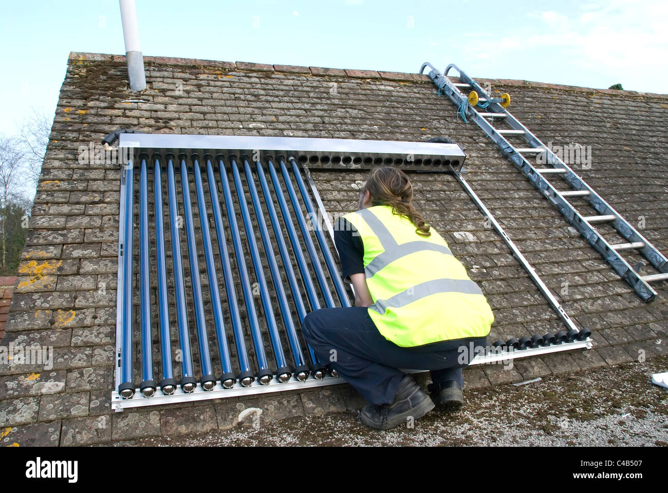 Engineers Installing Solar Thermal Evacuated Tube Array On The Roof Stock Photo 37124759 Alamy - Solar Tube Installation