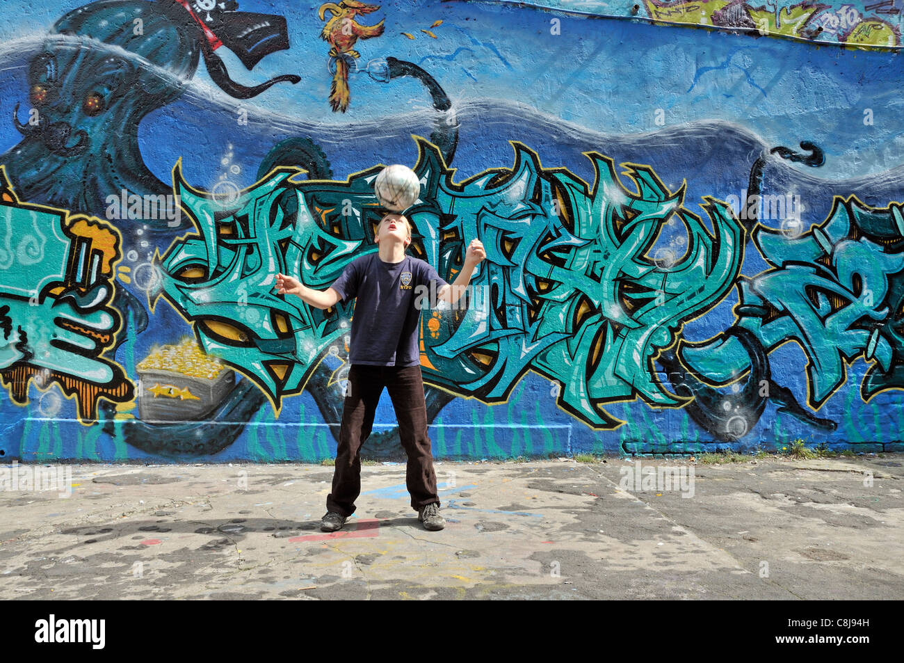 Stock photo alone balance balance ball germany one europe football soccer graffiti graffiti wall boy child head training more