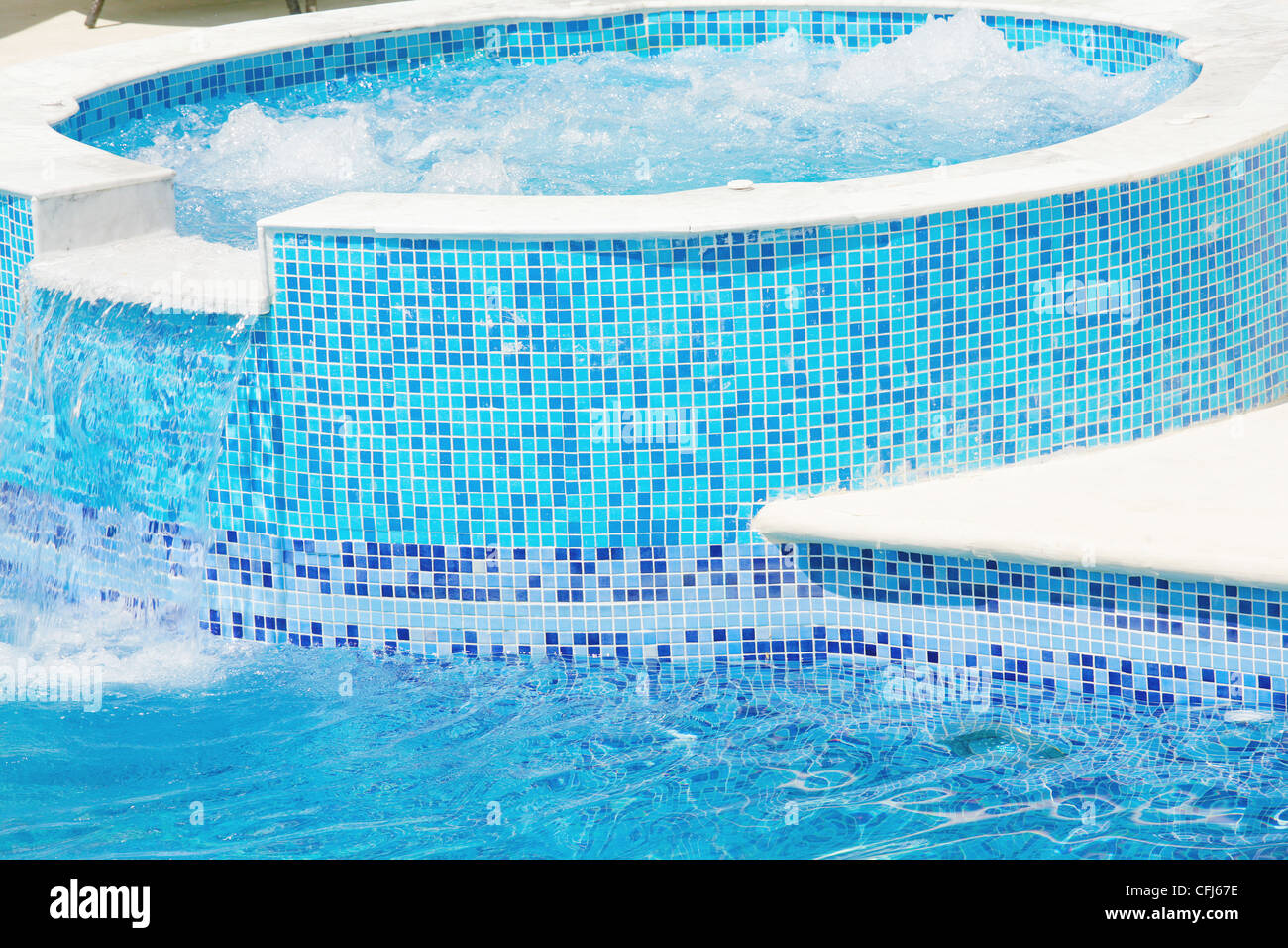 Jacuzzi In The Pool Empty Swimming Pool With Waterfall Jet And Jacuzzi In Action Stock
