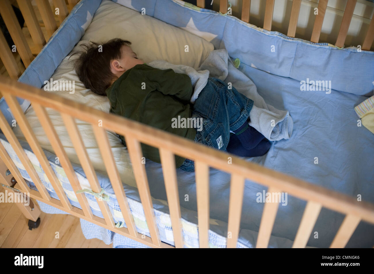 Crib Mobile Usa Two And 1 2 Year Old Boy Clutches His Favorite Blanket As