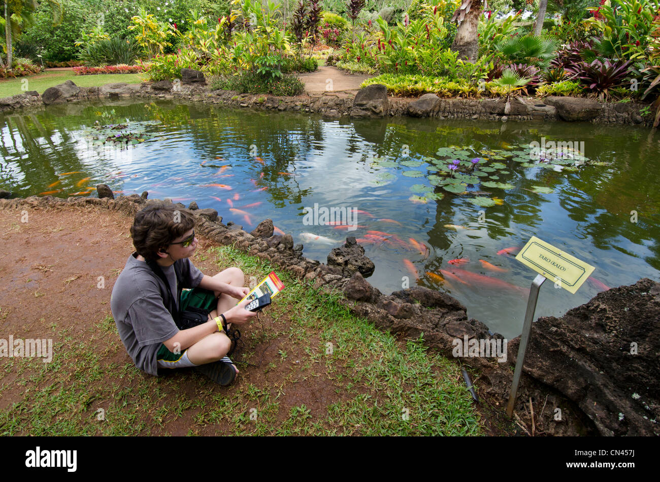 Boy Using The Audio Tour At The Plantation Garden Tour At The Dole Stock Photo Alamy