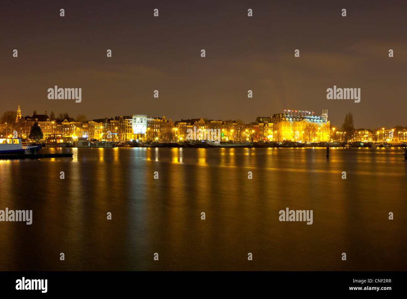 Amsterdam Skyline Amsterdam Skyline At Night With Historic Buildings And