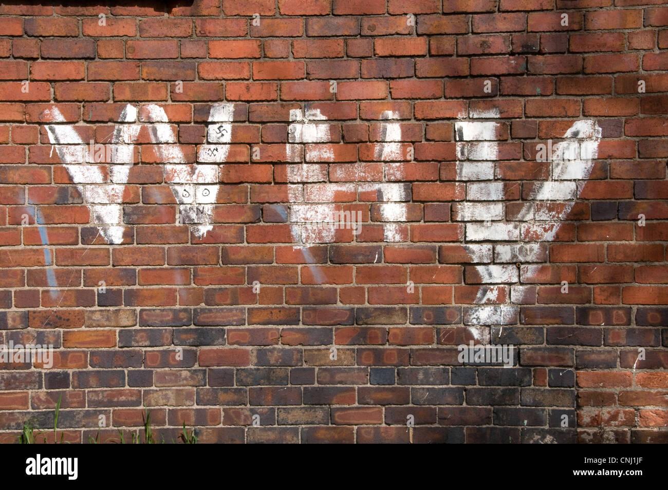 3d Brick Wallpaper Uk Graffiti On A Red Brick Wall Stock Photo 47724951 Alamy