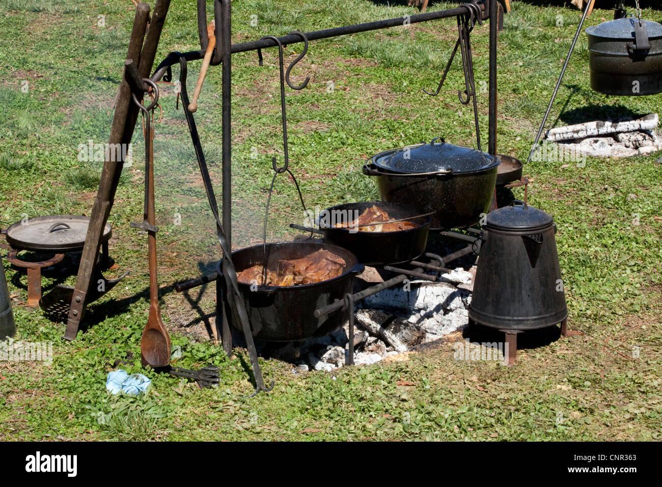 Cast Iron Pot Cooking Over A Camp Fire With Cast Iron Pots And Coffee