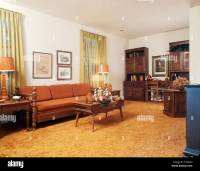 1970s LIVING ROOM WITH ORANGE COUCH SHAG RUG Stock Photo ...