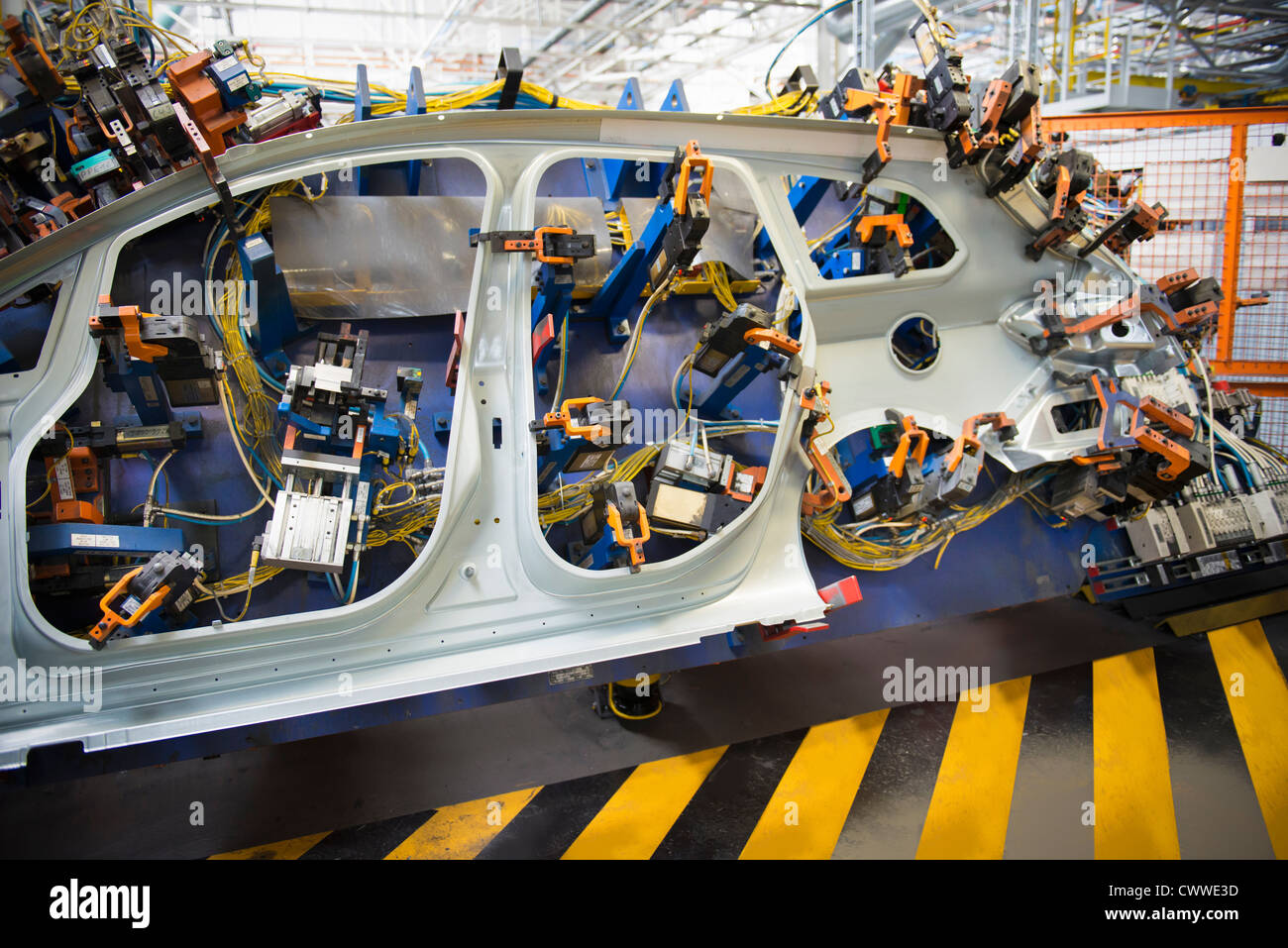 Factory Manufacturer Parts Car Parts On Welding Jig In Car Factory Stock Photo