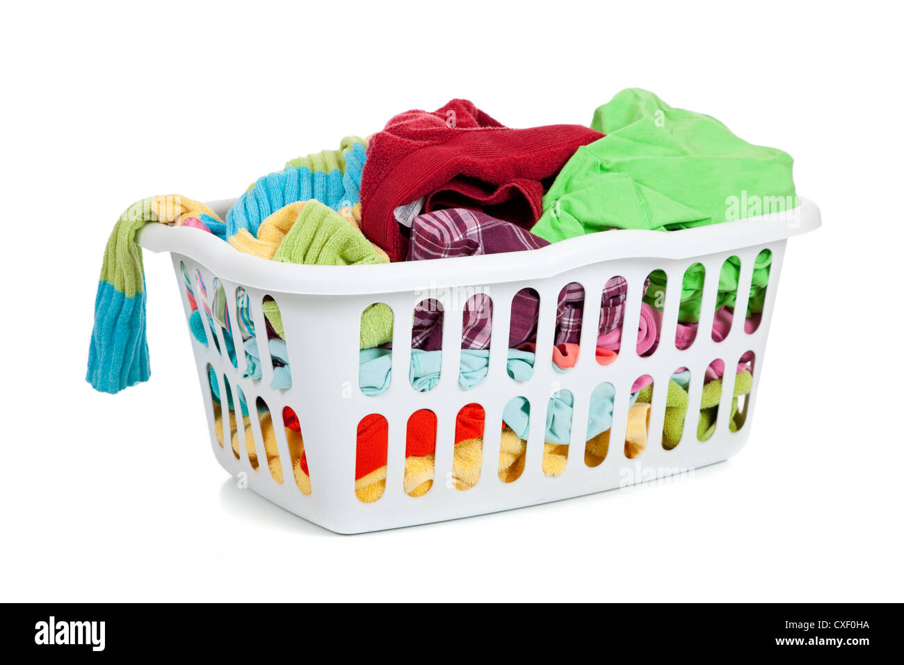 Clothes Baskets White Plastic Laundry Basket Full Of Dirty Clothes Stock