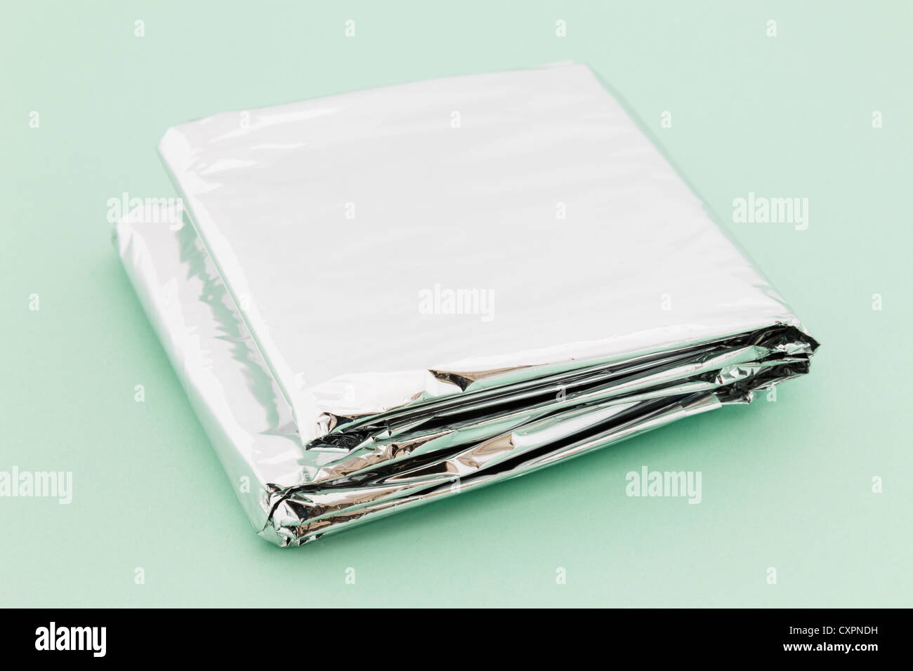 Foil Insulation Blanket Insulating Foil Emergency Blanket Folded Up On A Green Background