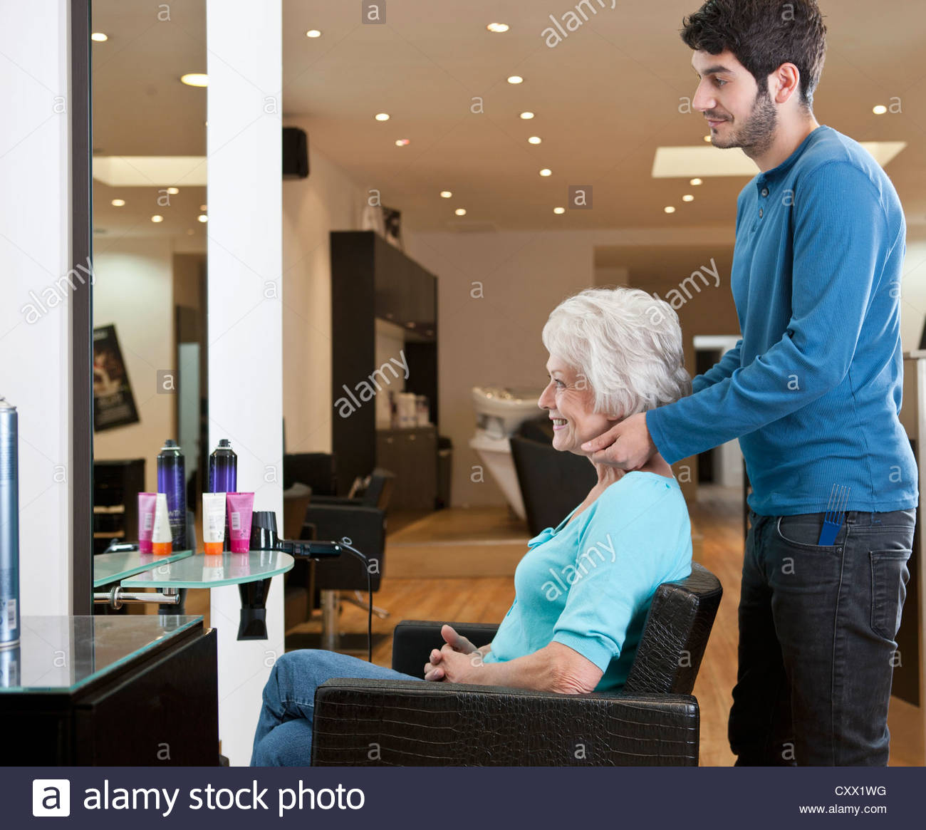 Salon Senior A Senior Woman At A Hairdressing Salon Admiring Her New