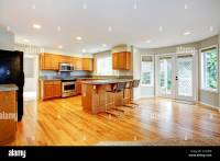 Large empty open kitchen with living room with balcony ...