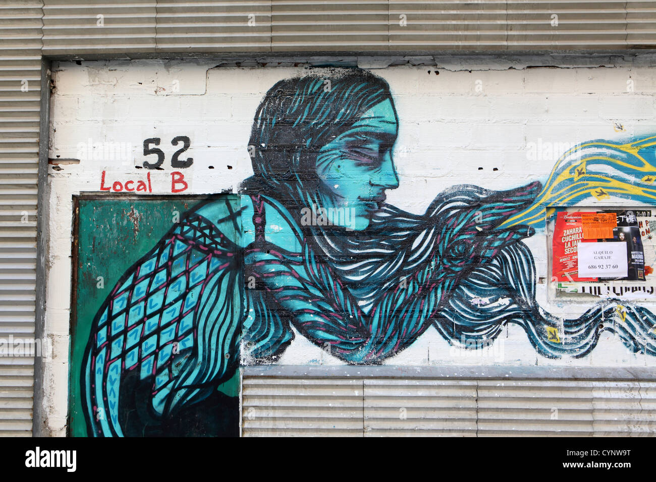Street art graffiti wall painting of woman with long hair self expression madrid spain espana