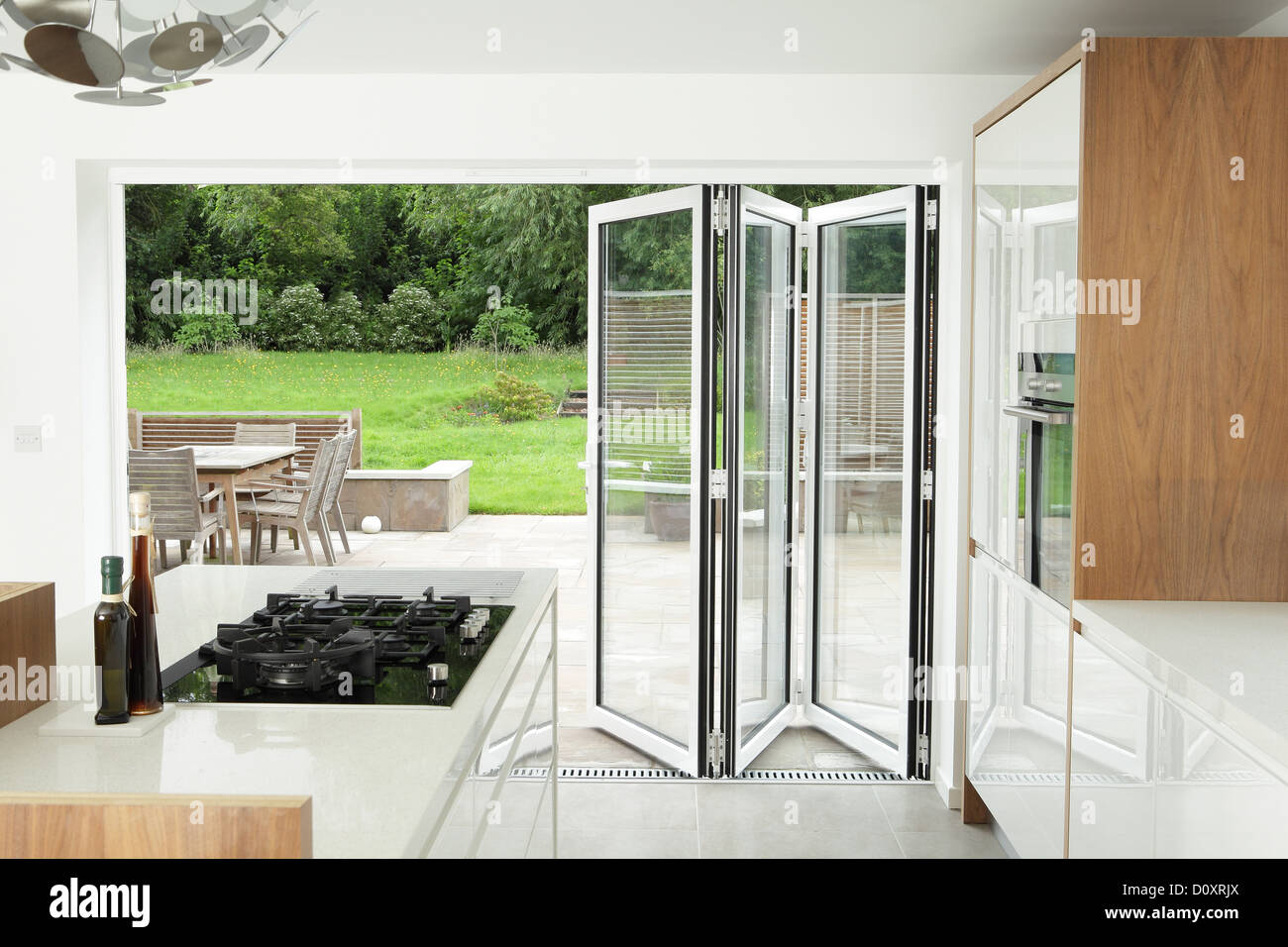 Kitchen with open patio doors Stock Photo, Royalty Free