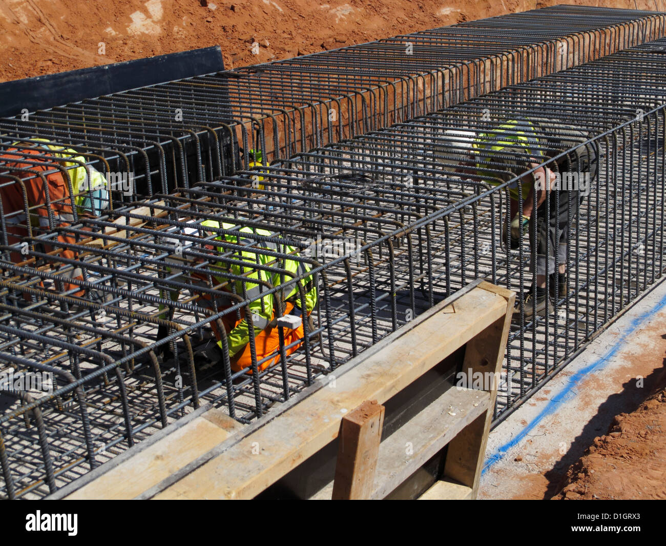 Construction Engineering Building And Steel Fixer Tying Reinforcement Bars In A Bridge Foundation Base