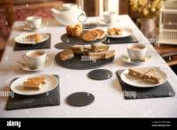 Afternoon tea table setting using welsh slate placemats ...