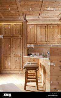 Natural wood finished alpine kitchen cabinets and table ...