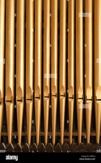 gold painted paint wooden metal church organ pipes wind ...