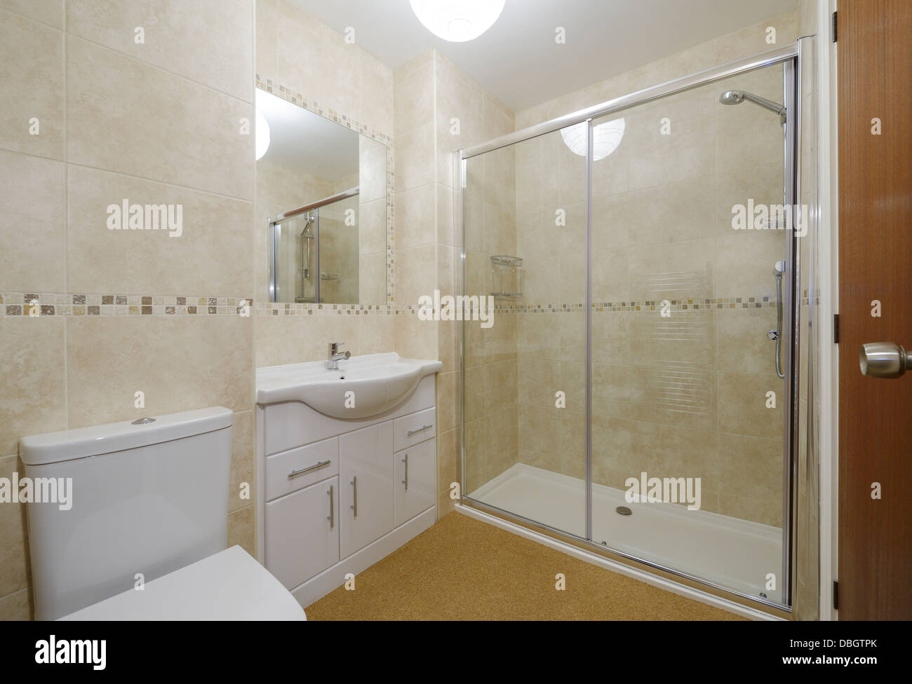 Modern Small Bathroom With Toilet Basin And Shower Stock Photo Alamy