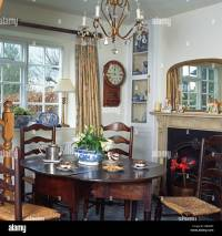 Rush-seated ladder back chairs and antique oak table in ...