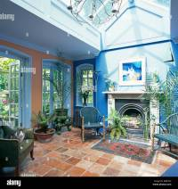 Terracotta tiled floor in conservatory living room with ...