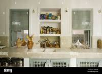 Moroccan style kitchen with tiled worktop and recessed ...