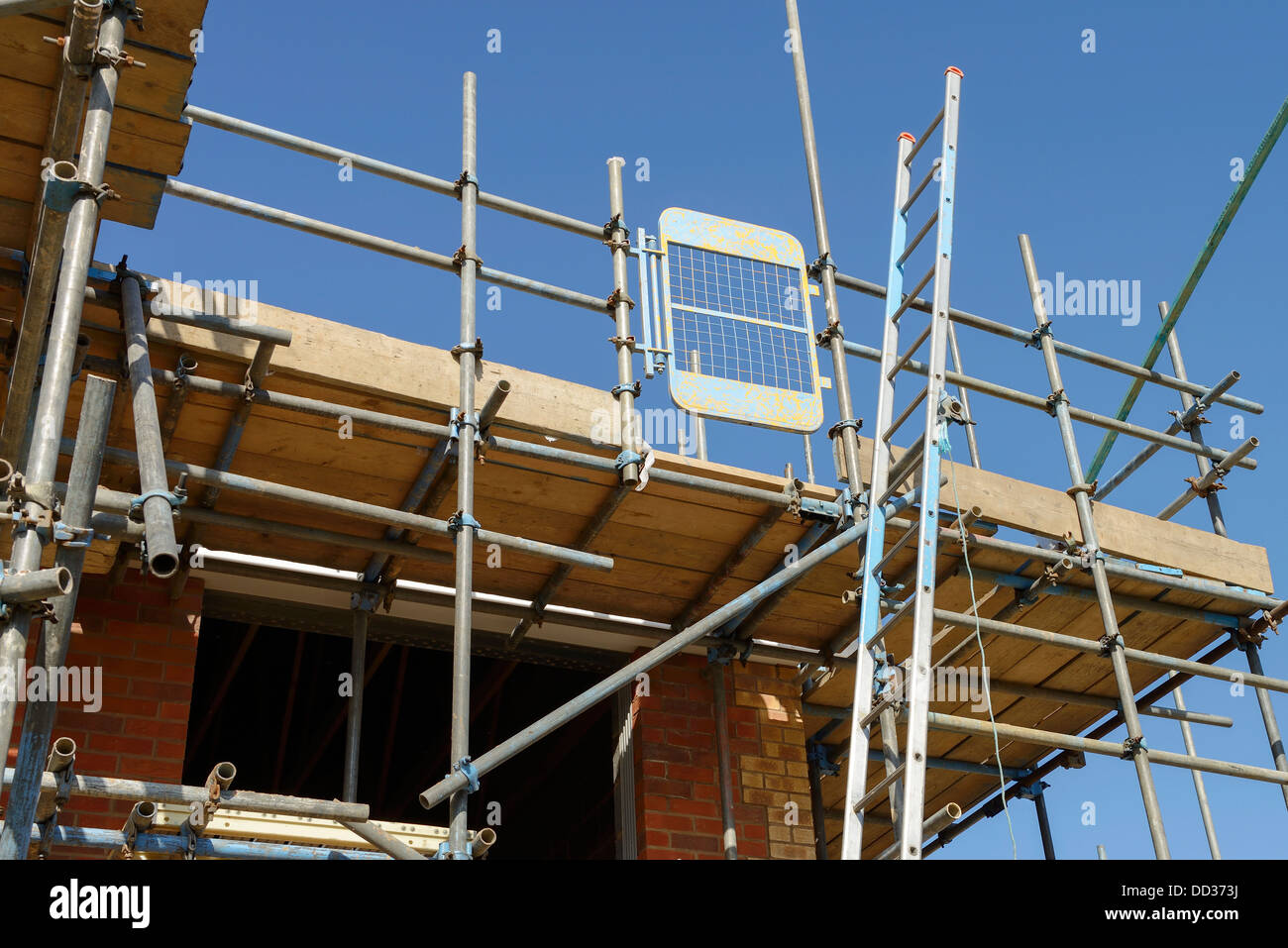 Scaffolding And A Ladder Access Safety Gate On A Building