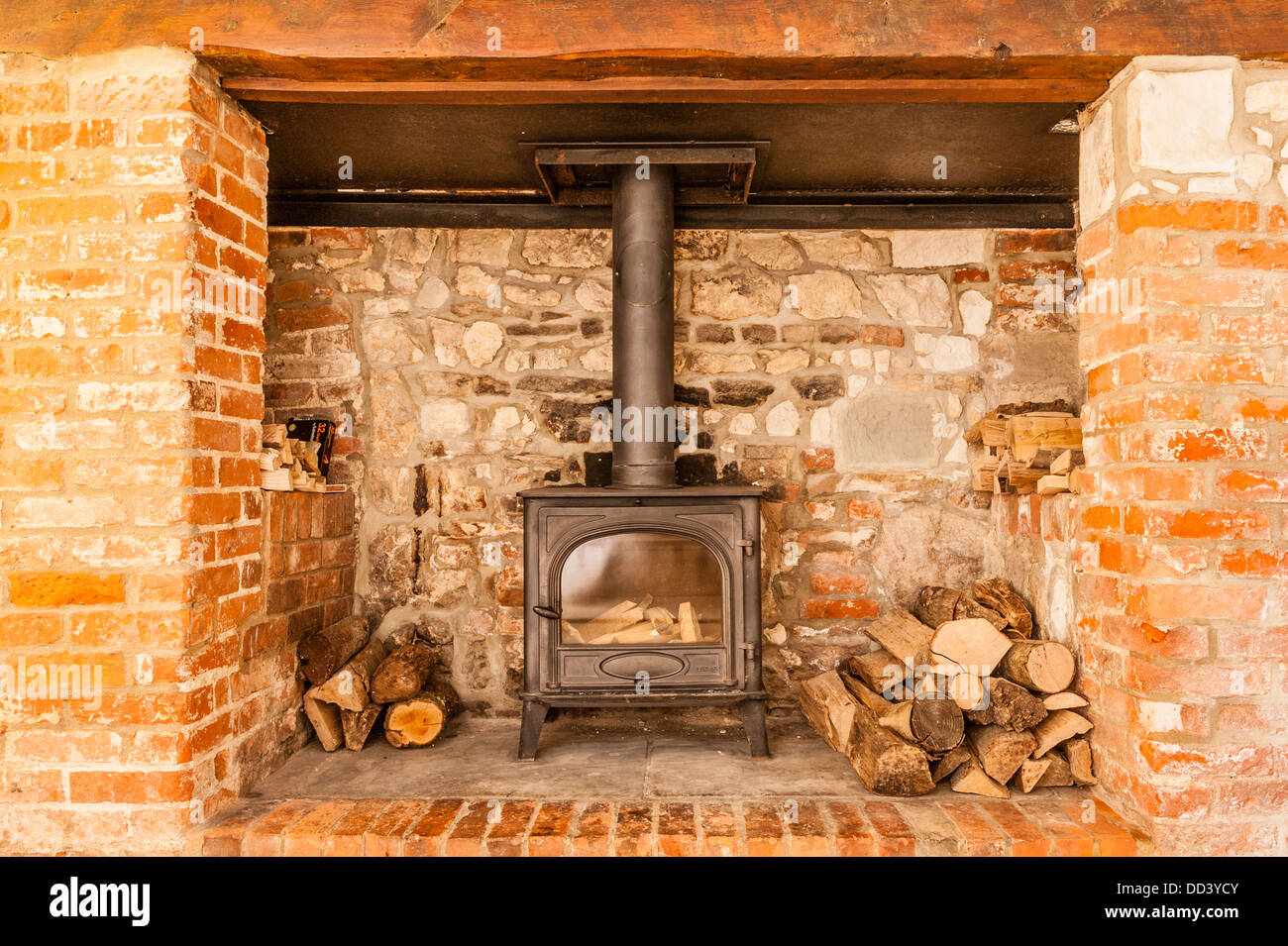 An Inglenook Fireplace With A Woodburner Stock Photo