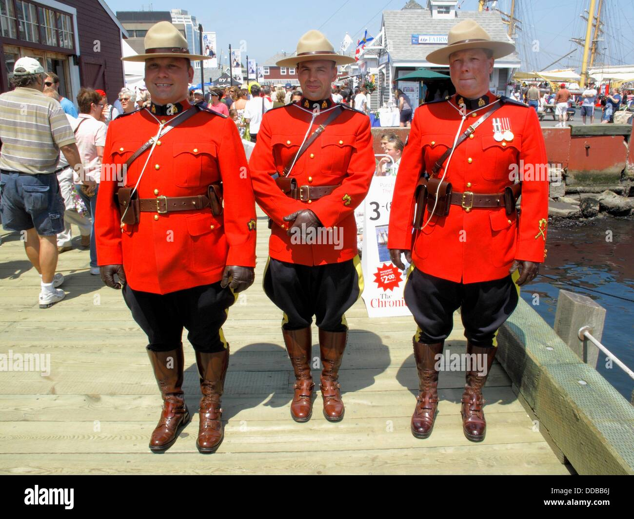 Three Royal Canadian Mounted Police Officers In Red