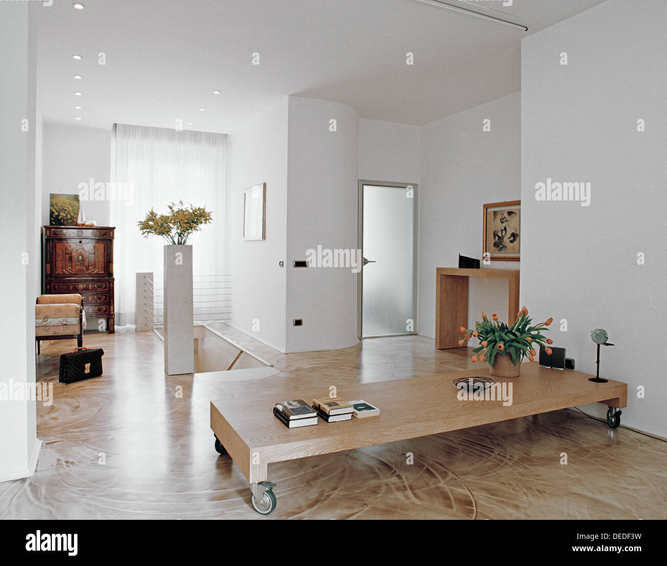 Df Mobili Modern Living Room With Old Furniture And Resin Floor Stock Photo
