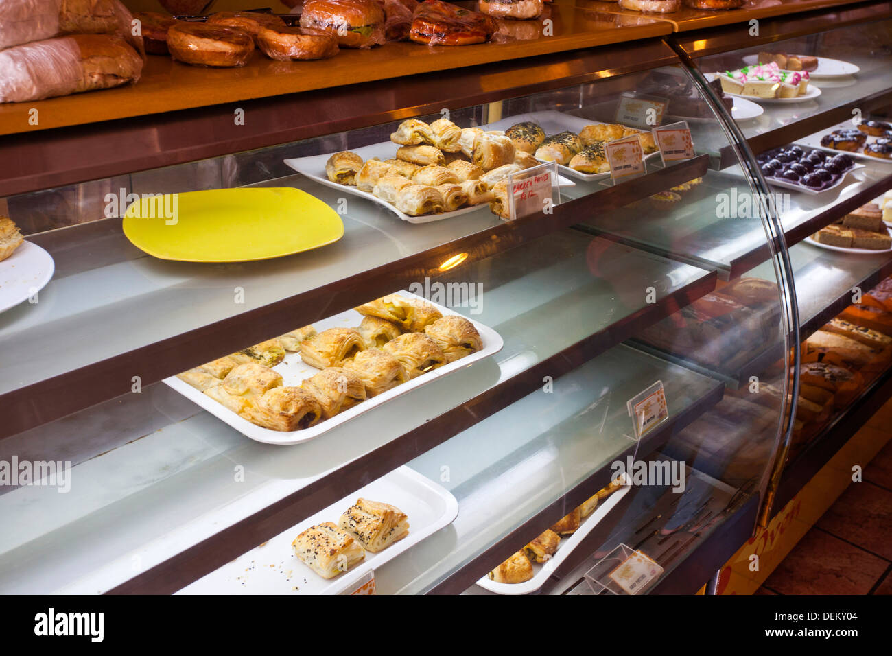 Bakery Display Cabinet Close Up Of Bakery Products In Display Cabinet Golden Oven Cake