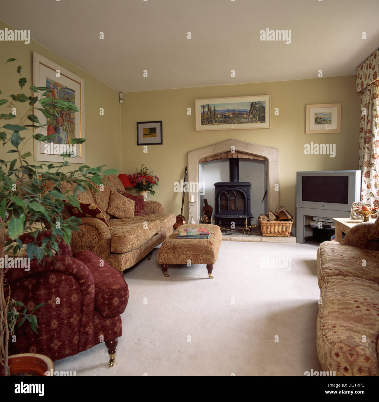 Cream carpet and neutral patterned sofas in country living