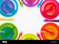 Colourful plastic plates, cups, bowls, spoons and forks ...