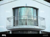 Curved balcony with glass door and stainless steel ...