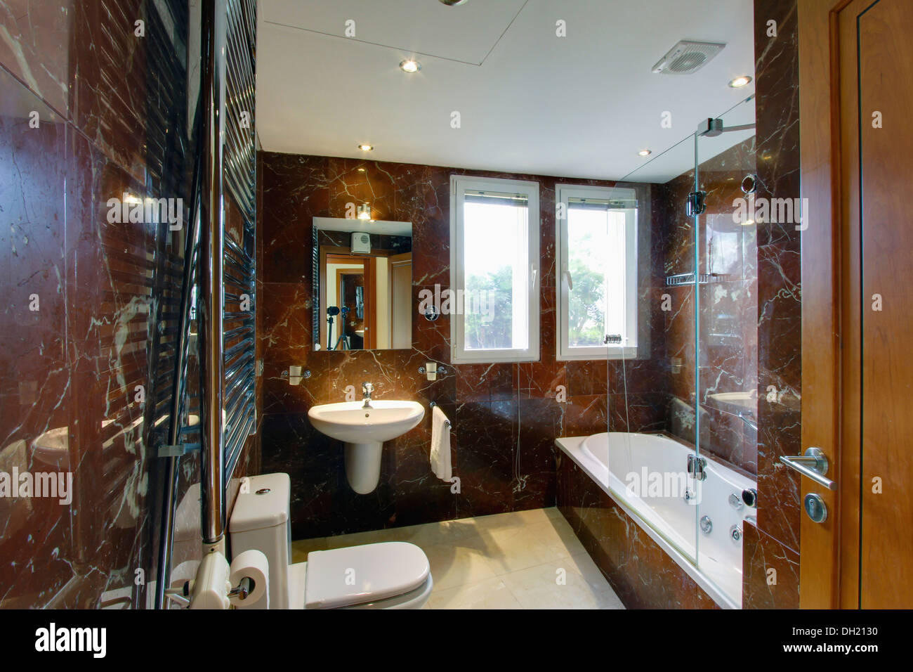 Bathroom In Spanish Modern Brown Marble Spanish Bathroom With Lighted Mirror Above