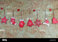 Rustic shabby chic Christmas decorations hanging against ...