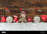 Rustic shabby chic Christmas decorations hanging on brown ...