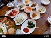 Typical Korean side dishes setting at restaurant table ...