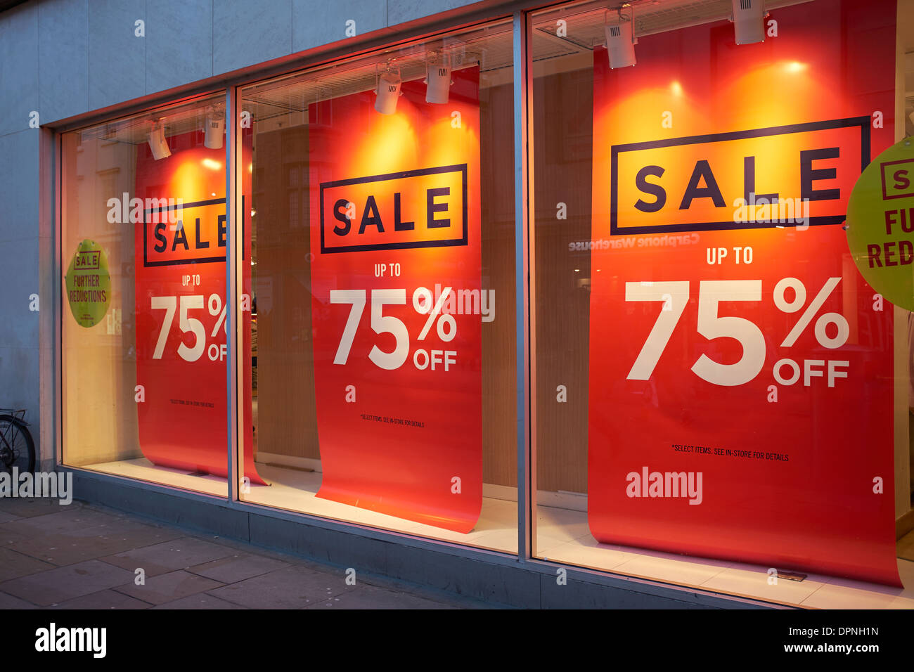 Store Banne Promotion Sale Up To 75 Off Banners In A Shop Window Stock Photo