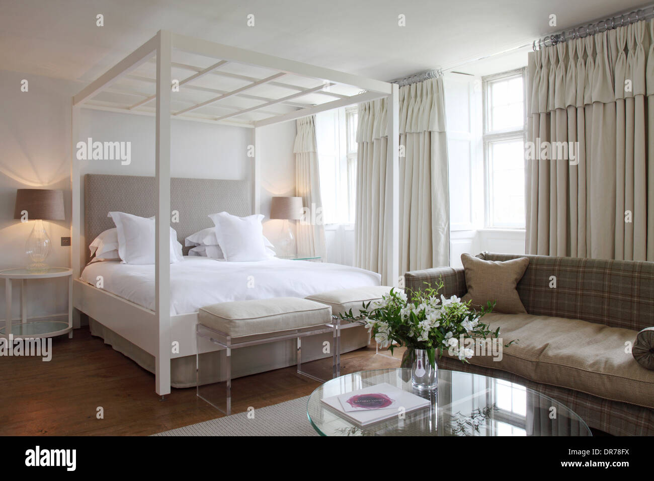 4 Post Bed White White Four Poster Bed In Hotel Suite With Flowers On Glass