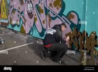 Graffiti Artist Spray Painting Wall Stock Photos ...