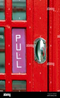 Red telephone box door handle, UK Stock Photo: 67875352 ...