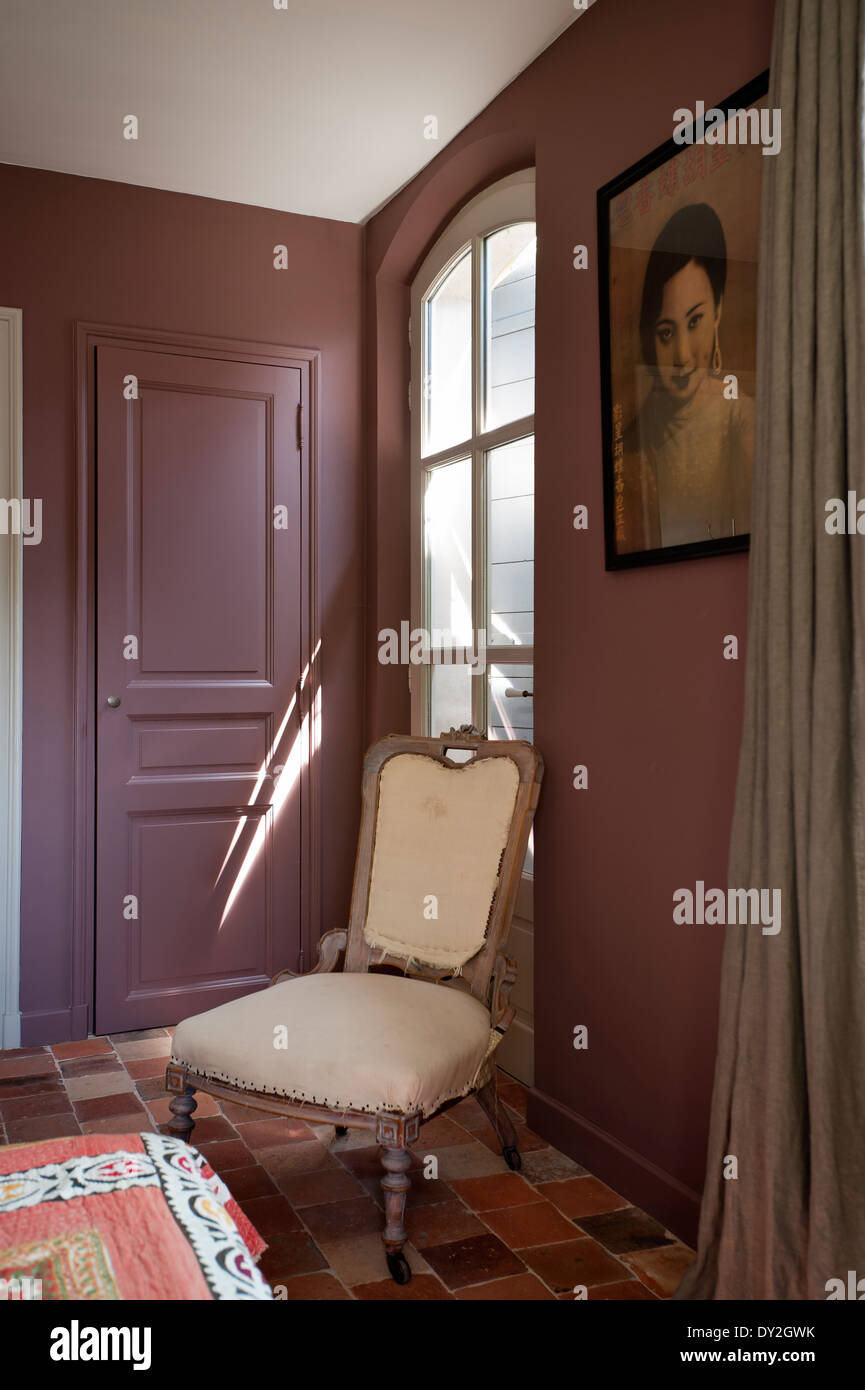 Emery Et Cie Upholstered Wooden French Chair In Bedroom With Terracotta Floor
